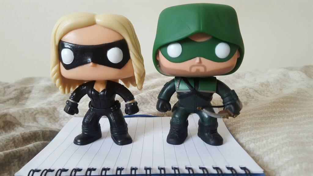 Black Canary and green arrow funk figurine's