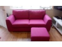 Mulberry coloured three seater sofa and footstool