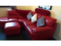 Red leather corner sofa with storage foot stool