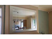 Silver frame wall mirror