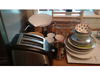 Plates, cups, mugs, pots, pans, cutlery, toaster,