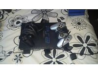 Ps2, 2 controllers, 10-15 games, 2 dance mats
