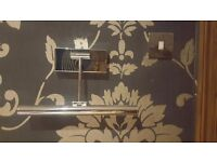 A pair of wall lights in polished chrome - excellent condition