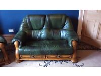 2 x two seater sofa, green in colour with wooden sides