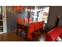 table with 6 leather chairs