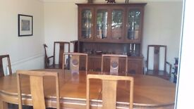 Stylish hand made teak dining room set including 8 chairs, table and display cabinet