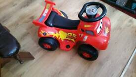 Electric toy racing car with charger. Feltham