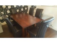 Ex John Lewis dark wood dining table with 6 leather chairs.