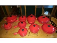 Le creuset volcanic orange complete cast iron set