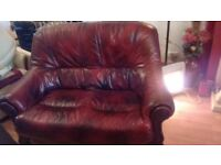 Leather 2seater. Good condition few marks with age. Beautiful sculptured wood