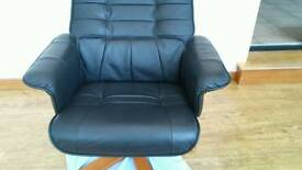 Black leather swivel recliner armchair