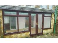 Conservatory with roof & guttering