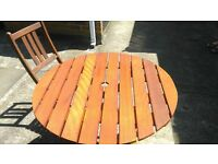 Wooden patio table and four chairs all folding