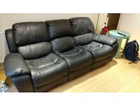 Faux leather sofa with recliners