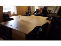 Office desks available in beech crescent shape