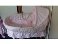 Moses Basket and stand with 2 sets of pink bedding