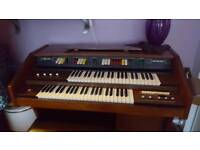 Electric organ with pedals..