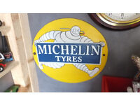 Michelin man cast metal sign raised well made