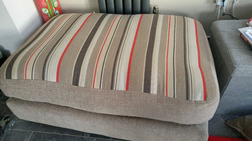 Two seater sofa with matching footstool and armchair.