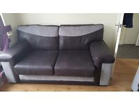 Beautiful black and gray sofa bed. Never been used
