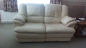 cream soft leather two seater recliner in good condition.