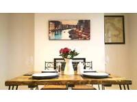 Industrial Style Dining Table Hand Crafted from Reclaimed Wood with Steel Hairpin Legs