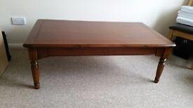 Coffee table,dark wood width 75 cms. Length 130cms. Height 45cms