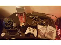xbox 360 plus two games and one controler