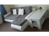 Corner sofa bed with storage + coffee table