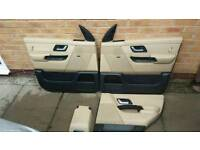 3 cream door cards and cubby box cover.rear passenger door card missing
