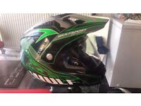 Green and black viser and built in glassice a wulf motocross helmit