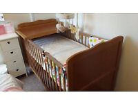 Cot bed-new and unused; plus bedding.