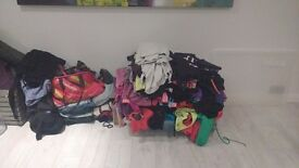 MASSIVE job lot of women's designer sports clothes- including jeans. HUNDREDS of quality items
