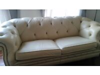 Beautiful cream leather chesterfield sofa.