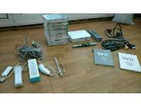 Wii console, 16 games and associated accessories