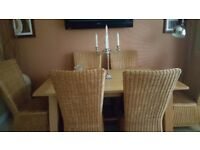 Oak dining table 6 rattan chairs and matching sideboard