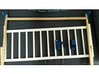White wooden bed guard
