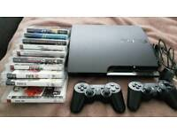 SONY PLAYSTATION 3 SLIM WITH CONTROLS AND GAMES