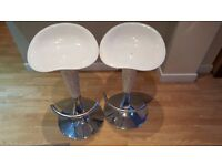 Two white bar stools