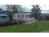 6 birth static caravan situated next to Dartmoor.