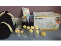 Medela double action breast pump with swing plus bag and loads of accessories