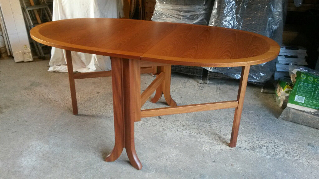 Oval Shape Double Drop Leaf Dining Table