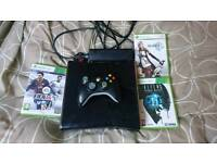 A xbox Slim and games