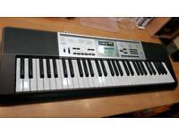 Casio LK260 61 keys keyboard lights up ideal first piano electric almost new
