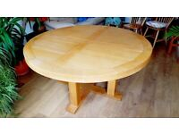 Round, chunky and solid oak dining table