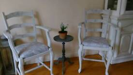 Two matching French ladder back carver chairs