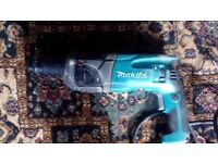 Makita 110 volt hammer drill with chisel action ex condition