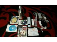 Nintendo Wii with Controller, Nunchuk, Games