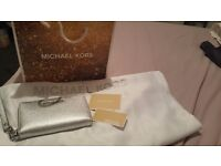 Genuine michael kor,s purse bought the wrong size and too late to return. Brand new never been used