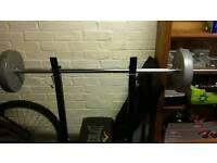 Bench,weights,bar and dumbbles